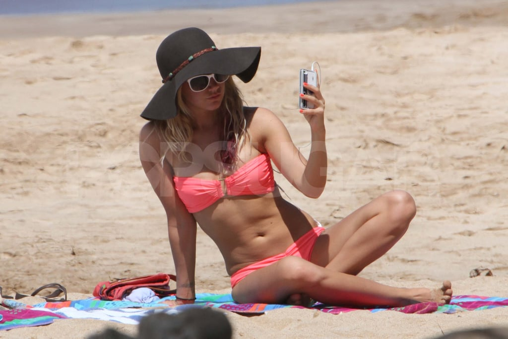 Ashley Tisdale splashed in the waves with a friend in Maui yesterday. She and her pal lounged in the sand in their bikinis and snapped pictures of themselves under the sun. Ashley got away for a Hawaiian vacation just in time for Spring, after also donning a two-piece last month. She was just one of many celebrities in bikinis this Winter, including her friend Selena Gomez. Selena wore a swimsuit while filming Spring Breakers in Florida alongside Vanessa Hudgens last week. The duo rode around on Vespas and later moved to the water, where they splashed around for the cameras.