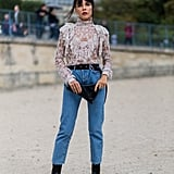 Tuck a frilled blouse into your favorite mom jeans.