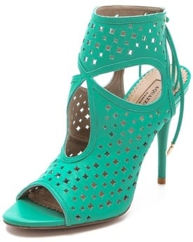 These Aquazzura Sexy Star Cutout Booties ($485) would be a great pop of color against a pair of white skinnies.