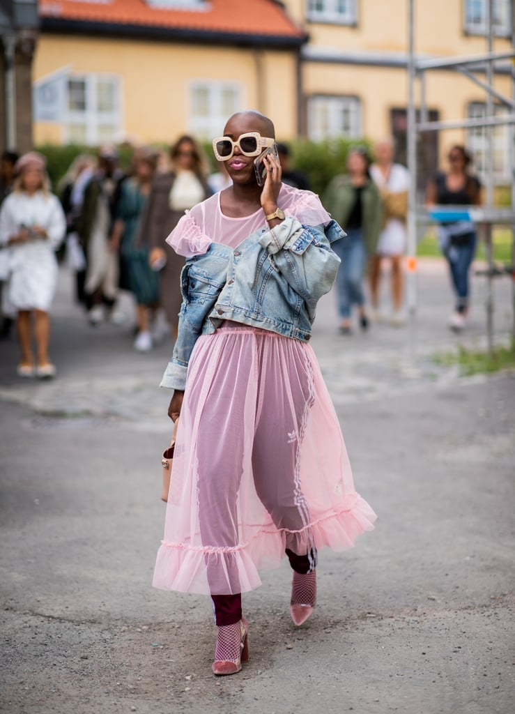 Styling a pink sheer dress with a denim jacket.
