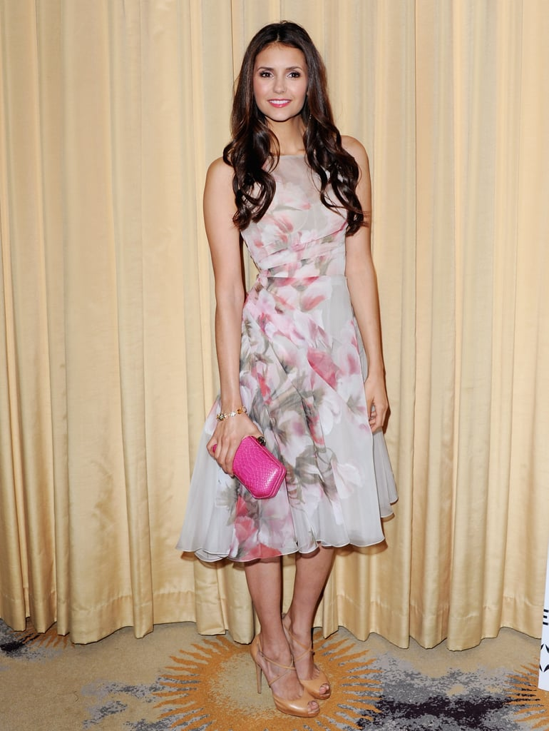 How gorgeous does Nina look in this tea-length floral Monique Lhuillier dress at a 2012 Golden Globes preparty? She styled the look with slick nude pumps and a bright pink clutch.