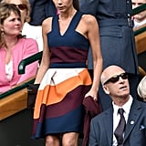 Wearing a colorblock sundress from her own collection at Wimbledon in July 2014.