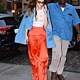 What Matches: Gigi's orange lenses and her Christian Siriano silk pants. She played up the notable combination with the cutest graphic t-shirt.