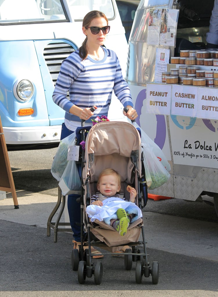 Jennifer Garner pushed her son, Samuel, in his stroller on Sunday at the Brentwood farmers market in LA.