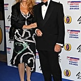 Jerry Hall looked classy in a calf length dress.