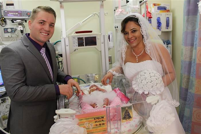 "Although Rubia Ferreira and Tyler Campbell planned to marry each other in the city they met, Okinawa, Japan, after welcoming their first child, who was due in February 2018, a series of unexpected events changed the couple's plans. In November 2017, the pair were visiting Campbell's family in Alabama when Ferreira began experiencing abdominal pain at 24 weeks pregnant. She was rushed to the University of Alabama at Birmingham hospital, where she was diagnosed with HELLP syndrome — ""a series of symptoms that affect pregnant women, including the breakdown of red blood cells and elevated liver enzymes"" — and rushed into an emergency C-section surgery to save her and her baby's lives. Ferreira pulled through the surgery, as did her and Campbell's first child, a daughter they named Kaelin Maria. Since her early birth in November, Kaelin has been a resident in UAB's NICU, where her mom and dad did some talking and realized they were having second thoughts about their wedding — they decided that maybe, instead of getting married in Japan as planned, they'd tie the knot a bit earlier, right in Kaelin's hospital room. And the entire team at UAB stepped right up to make that happen. ""We had never had a wedding of this size and scale in the RNICU, but everyone was willing to do whatever it would take to make it a reality,"" said Sandra Milstead, RN, BSN, family nurse liaison in UAB's Women and Infants Center. ""So many people at UAB had formed relationships with Tyler and Rubia, and we all wanted to make sure that, although taking place in a hospital, this was the wedding of their dreams. That's what they deserved."" So on Feb. 14, after two weeks of planning, Ferreira and Campbell were married in the NICU next to their daughter's crib. Ferreira walked down the aisle — aka the hospital hallway — with Kaelin's neonatologist, Waldemar Carlo, MD, director of UAB's Division of Neonatology, and a wedding cake and other refreshments were supplied by university catering. The makeshift hospital ceremony left not a dry eye in the house, and the couple couldn't be more thrilled.      Related:                                                                                                           Holy Crap, This Woman Gave Birth in the ER Hallway and Her Photographer Caught It All!               ""UAB has helped save not only my life, but my daughter's as well, and it meant the world to share this milestone with our new family here,"" Ferreira told UAB News. Campbell added, ""We want Kaelin to look back at pictures from our wedding and know about our experience as a family at UAB. We hope she understands how much we cared for and loved her, and that it meant the world to us to have our wedding take place right there with her."""