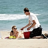 AnnaLynne McCord smiled as she bought a Big Stick Popsicle from a vendor on the beach.