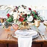 Simple china and metallic flatware keep focus on the flowers.