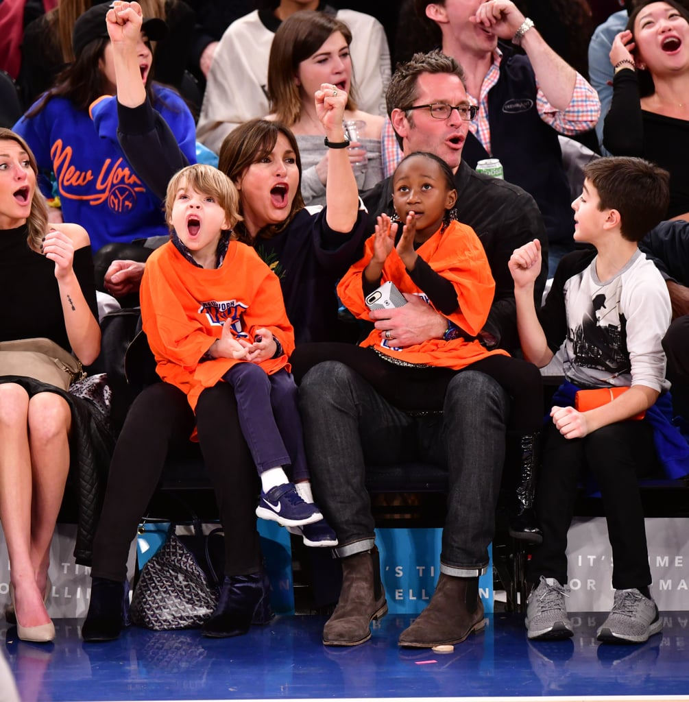 peter hermann and mariska hargitay with family at game