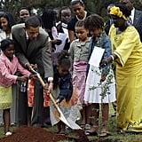 Planting a tree with his family and Nobel Prize winner Wangari Maathai while visiting Kenya in 2006