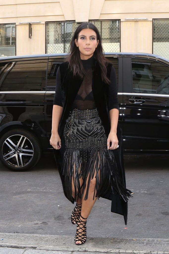 Kim was spotted on the streets of Paris in this sheer top and fringe skirt combination in 2014.