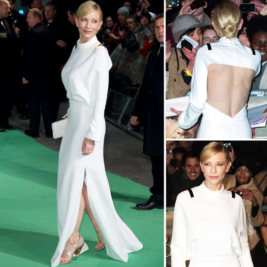 Last night at the UK premiere of The Hobbit, actress Cate Blanchett stunned on the green carpet in a trendy white long, Givenchy dress designed by Riccardo Tisci accented with gold epaulettes. She paired the dress with nude and clear heels, a white leather envelope clutch and understated jewellery. Her beauty style was just as classic as her hair was styled in a low chignon and rosey-coral hued lips. Take a peek at her gorgeous gown from all angles and let me know what you think of her look.