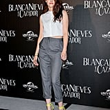 For her press conference appearance in Mexico City, Kristen Stewart stepped out in a menswear-inspired outfit. On top, she wore a crisp cropped white shirt by Marios Schwab. On bottom, she opted for Vivienne Westwood gray cropped trousers and a pop of color via Christian Louboutin ankle-strap heels.