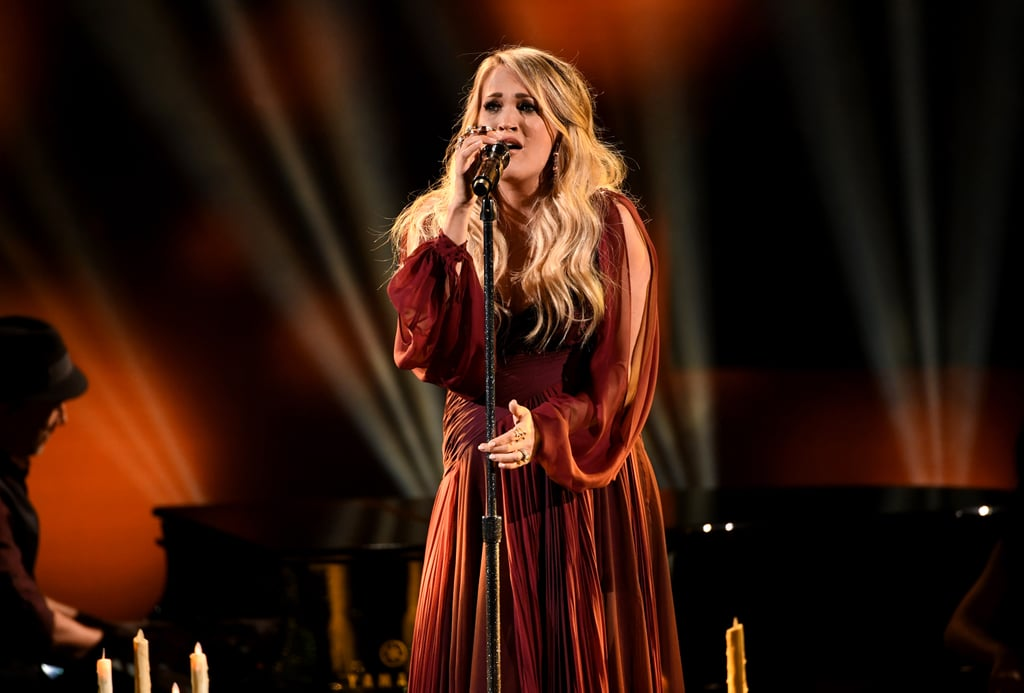 """Carrie Underwood got up on the American Music Awards stage on Tuesday night and didn't leave a single dry eye in the house. In her second live performance since announcing her pregnancy with baby number two, the country singer passionately belted out """"Spinning Bottles"""" from her new album Cry Pretty. Considering that the music for her album was written during some difficult times over the last few years, this performance is even more amazing than we thought. Watch the moving video ahead!"""