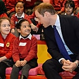 Prince William leaned in to chat with kids during story time.
