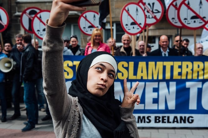 Muslim Woman Takes Selfie at Protest