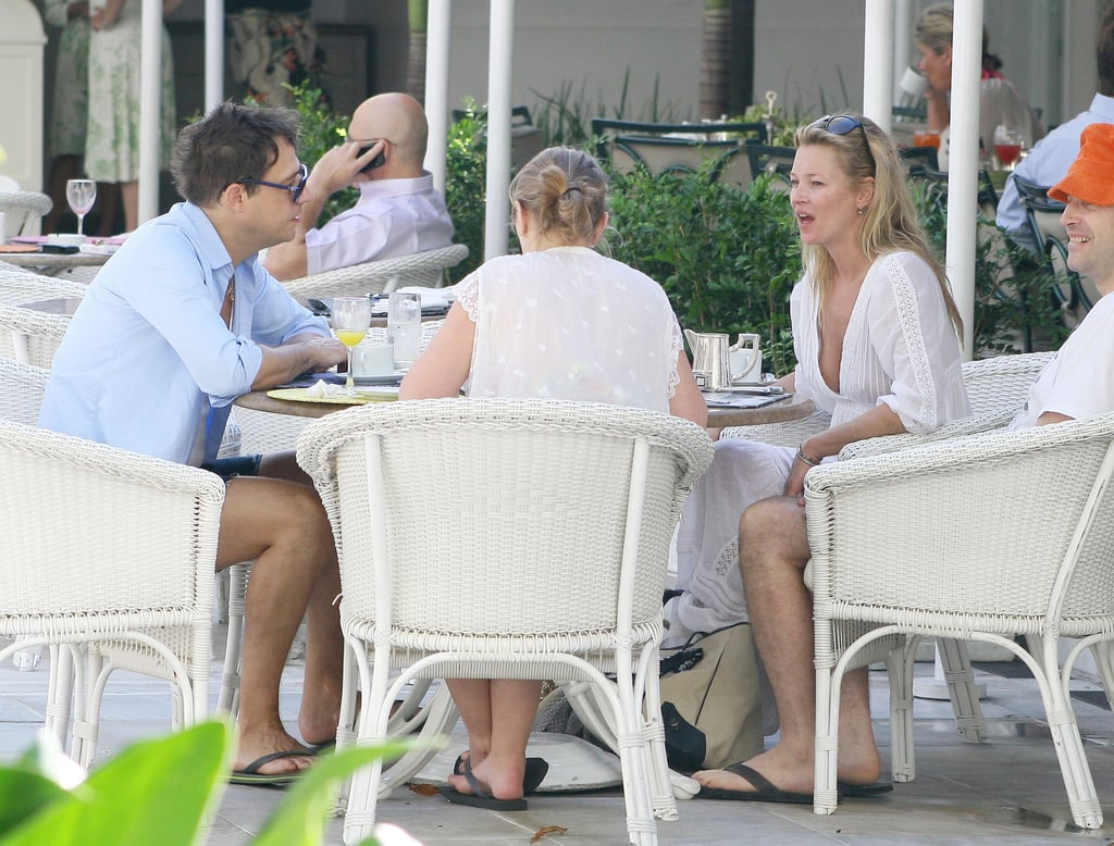Kate Moss arrived in Rio this weekend with her husband-to-be Jamie Hince and her daughter Lila Grace. She posed for photographer Mario Testino, with big hair and strong makeup, and she's also been enjoying some family time too. Kate sat down for breakfast with Jamie, Lila and some friends yesterday, wearing a simple white dress and flip flops in the sunshine.