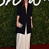 In 2014, Emma attended the British Fashion Awards in a white Misha Nonoo jumpsuit and Dior coat. She carried an Anya Hindmarch clutch.