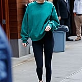 Kendall Jenner wore a simple sweatshirt with leggings and sneakers.