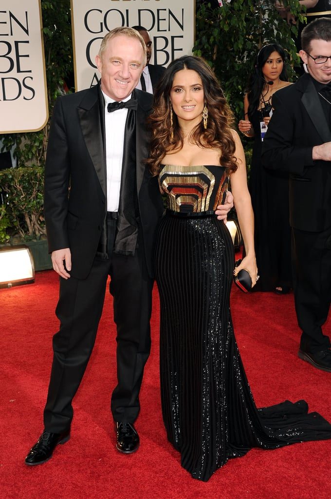 Salma Hayek and her husband Francois-Henri Pinault stepped out together for the Golden Globe Awards in LA today. Salma chose a bold Gucci gown, while Francois looked dapper in a tuxedo. Salma will be taking the stage to present the best TV comedy award later this evening. Make sure to vote on all of Bella and Fab's beauty and fashion polls!