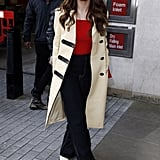 Selena was all about the nautical vibes in a Jacquemus cropped top, black trousers, Louis Vuitton coat, and Céline heels and sunglasses.