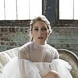 Wearing a Valentino dress.