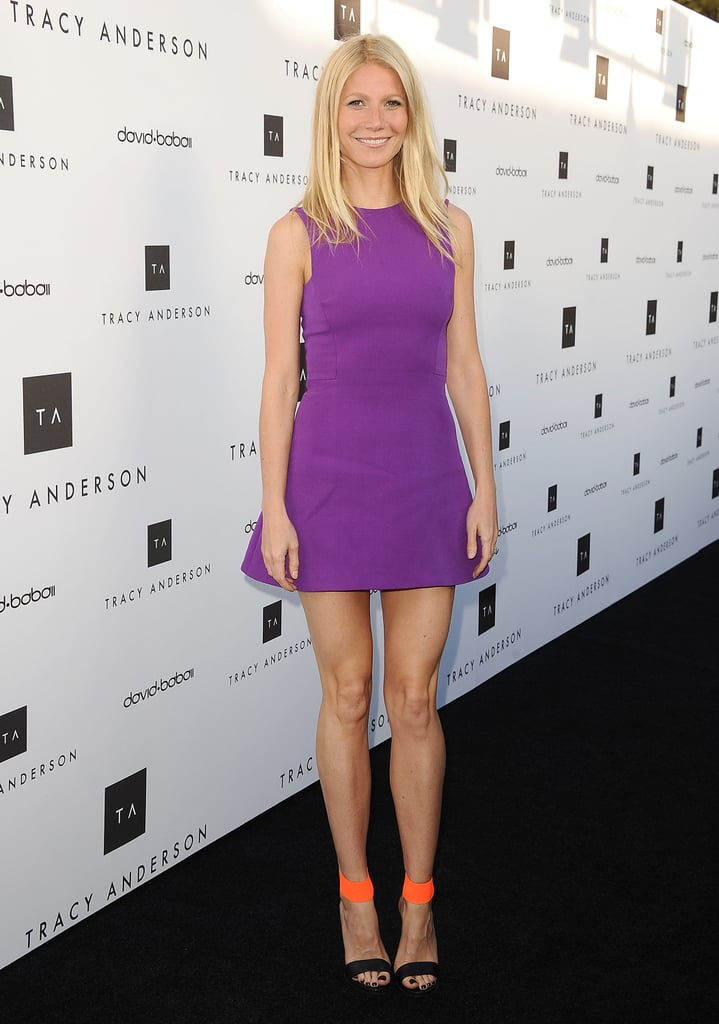 Gwyneth Paltrow donned a purple Victoria Beckham dress to support pal and trainer Tracy Anderson at the launch of her new flagship studio in LA's Brentwood neighborhood.
