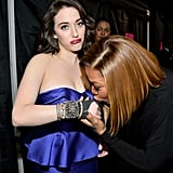 People's Choice Awards cohost Kat Dennings got a sweet kiss on her bandage from Queen Latifah.