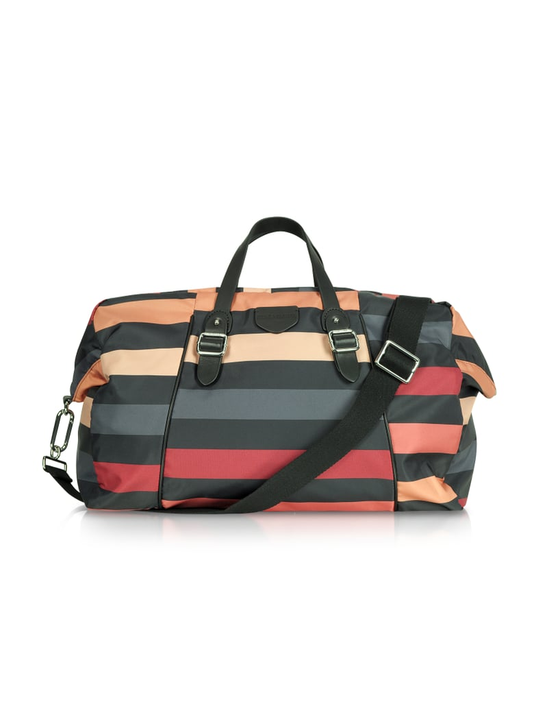 A quick getaway means skipping the oversize luggage. Pick up Sonia Rykiel's striped weekender ($435) instead.