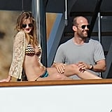 Bikini-Clad Rosie Huntington-Whiteley Welcomes 2011 Making Out With Jason Statham!
