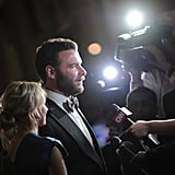 Liev Schreiber spoke to a reporter with Naomi Watts by his side.