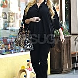 Jessica Simpson smiled as she put her hand on her pregnant belly.