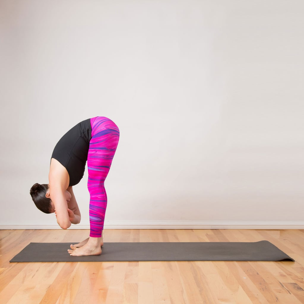 Standing Forward Bend Clasped Elbows