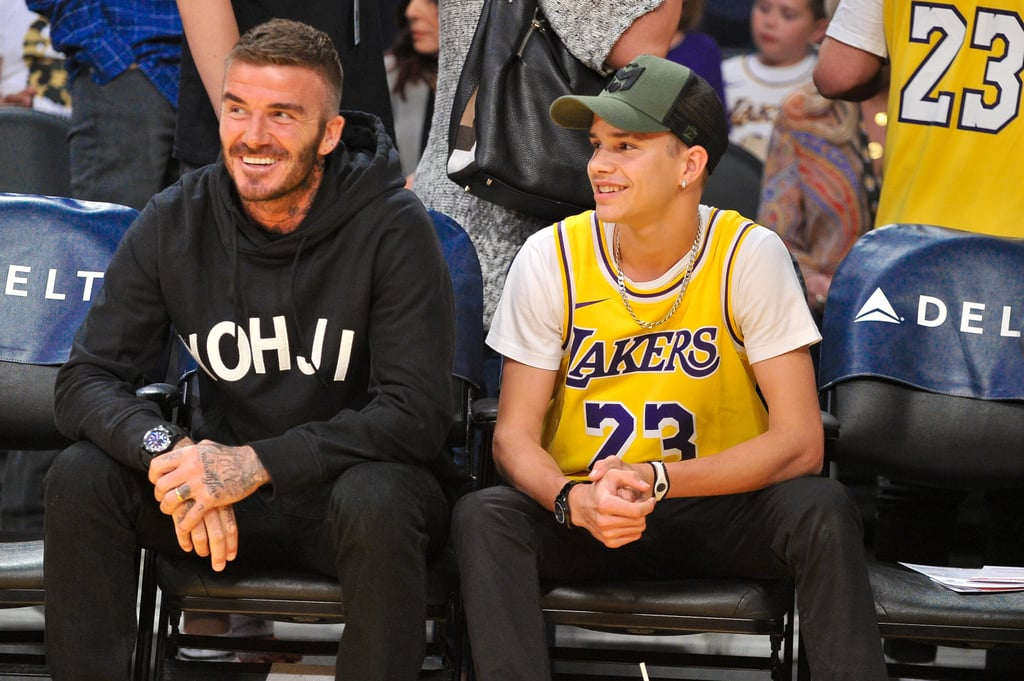 Twinning alert! David Beckham and his 17-year-old son, Romeo, attended a Lakers game together on Oct. 27, and wow, we thought Brooklyn was his dad's clone, but it appears as though Romeo has joined the lookalike club. In a series of photos of the adorable father-son pair, both David and Romeo can be seen sitting in the same positions, making the same facial expressions, and sure, we know they're watching a game, but their heads being turned in the same direction in each photo only adds to their similar appearances. Scroll through to see all of the twinning photos of David and Romeo — they're so cute!