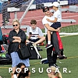 Ryan Phillippe carried his son, Deacon, at a track meet in LA.