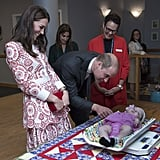 Kate and Will bonded with a baby girl while she got weighed during their Canada tour in September 2016.