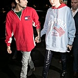 Gigi promoted her collection at Paris Fashion Week with the support of her boyfriend Zayn, styling her shiny pants with an oversize sweatshirt.