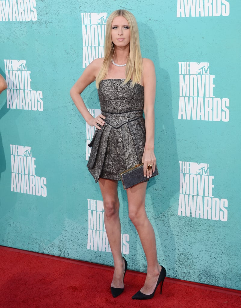 Nicky Hilton walked the red carpet at the MTV Movie Awards in June, clad in a strapless jacquard mini by Marco Marco.