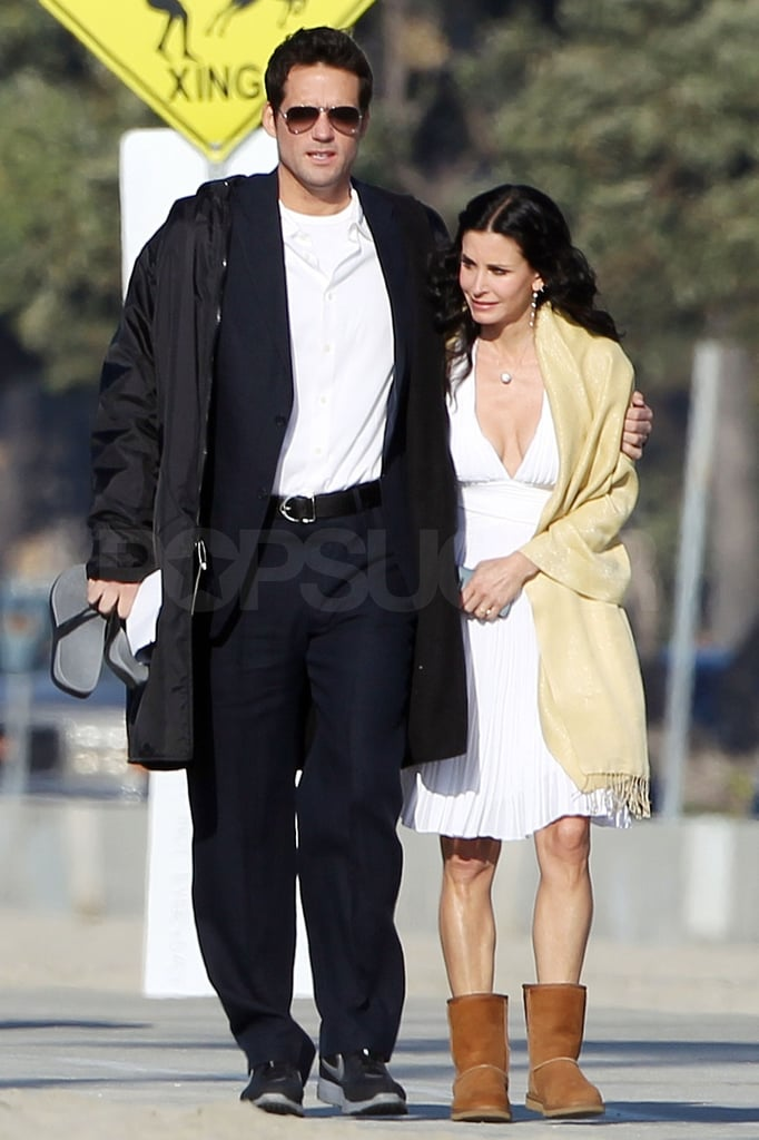 Josh and Courteney walked down to the shore together.