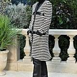 Tilda Swinton wore a tweed coat and corduroy newsboy cap.