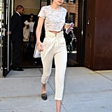 Instead of jeans, Gigi added interest to a t-shirt with high-waisted trousers.
