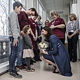 Kate's growing belly didn't stop her from kneeling down to greet 5-year-old Bella Kedwell-Parsons at the children's ward at St. Thomas's Hospital in London in February 2018.