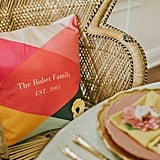 A family pillow created at Tiny Prints was used to designate the mom-to-be's seat.
