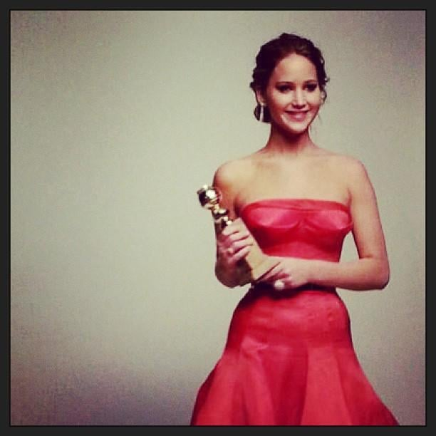 Jennifer Lawrence posed with her Golden Globe award. Source: Twitter user InStyle