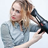 Blow-dry or diffuse, scrunching your hair lightly as you dry to encourage your natural texture to take form.
