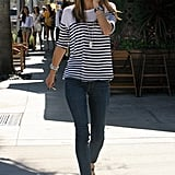 The model sporting nautical stripes with skinny jeans and sandals.