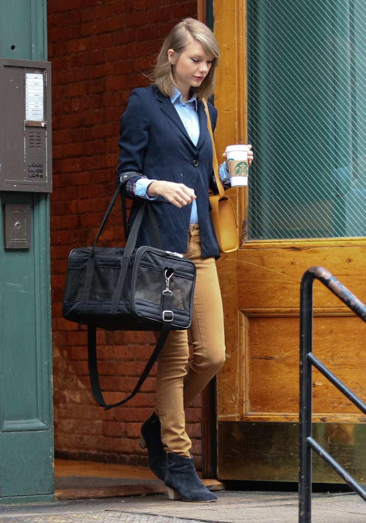 On Sunday, Taylor Swift carried her cat, Meredith, while running errands in NYC.