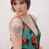 Lena Dunham takes the prize for most dramatic makeup moment of the night with this teal inner eyeshadow that was sourced from her Prada dress.