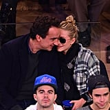 Mary-Kate Olsen cuddled during the game with her boyfriend, Olivier Sarkozy.