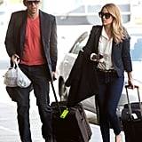Lauren Conrad pulled her carry-on luggage.